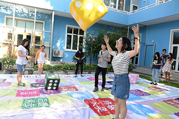 Young people play an HIV knowledge board game at an event to promote sexual and reproductive health among adolescents supported by the China Center for Health Education and UNICEF China.