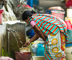 woman gathering water