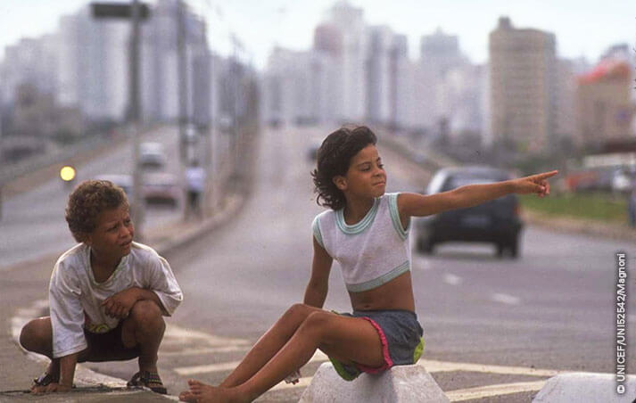Ligia, eight, plays with a friend on the boulevard of a major highway in Sao Paulo. With a population approaching 150 million, Brazil has an estimated 30 million children living in poverty, with more than 7 million aged 10-17 working to survive and almost one million abandoned to a life on the streets. To respond to their needs, a major part of UNICEF's US$47 million cooperation programme 1990-1995 working with NGOs and local authorities - provides literacy and other educational opportunities, while at the same time promoting non-exploitative income-generation for children who must work. UNICEF also supports advocacy to prevent violence against street children and to promote legislation to protect working children. Increased attention is also being given to the circumstances of girls living in poverty, forced to work or living in the streets, also recognizing their domestic work and their special educational, health and social needs.