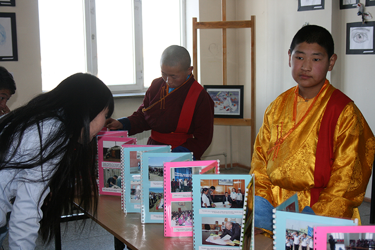 Kh.Tsolmon and M. Ulziisudar, Lama-students of Khuvsgul Temple are introducing their brochures on child led organization interventions – during Child Friendly Aimag – Annual meeting, 2014.