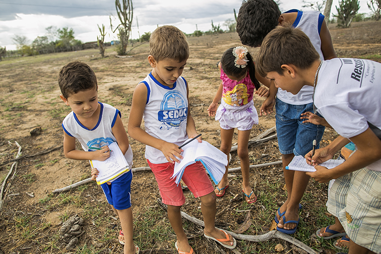 Children in Nova Fátima, state of Bahia, in 2016, at school during class about how to live with the drought as part of UNICEF Municipal Seal of Approval's methodology.