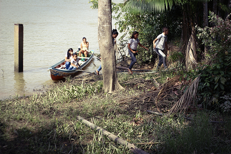 Children going to school in a riverside community in the Amazon region.